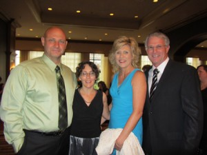 Authors Debra Clopton and Kathryn Springer with their spouses attending the ACFW 2011 Awards